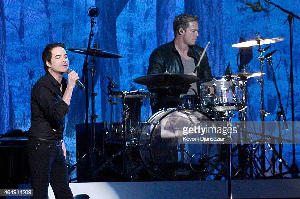 Singer Pat Monahan and drummer Scott Underwood of Train perform onstage at The 2014 MusiCares Person Of The Year Gala Honoring Carole King at Los...