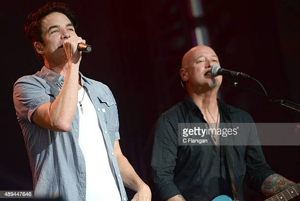 Singer Pat Monahan and guitarist Jimmy Stafford of Train perform onstage during 2015 KAABOO Del Mar at the Del Mar Fairgrounds on September 20, 2015...