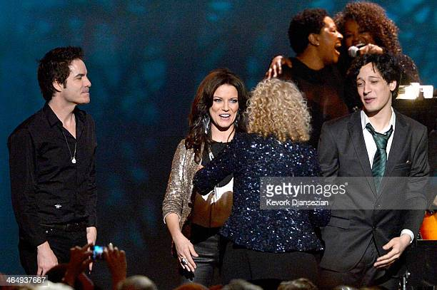 Singer Pat Monahan singer Martina McBride honoree Carole King and musician Ahmad El Haggar appear onstage at The 2014 MusiCares Person Of The Year...