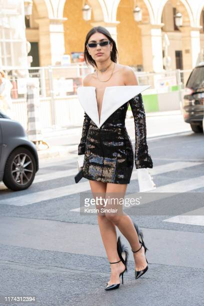 Singer Patricia Manfield wears a Balmain dress Saint Laurent shoes and Alexandre Vauthier sunglasses on July 03 2019 in Paris France