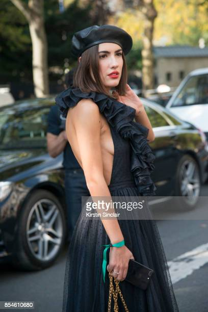 Singer Patricia Manfield wears a Dior hat and dress day 1 of Paris Womens Fashion Week Spring/Summer 2018 on September 26 2017 in Paris France