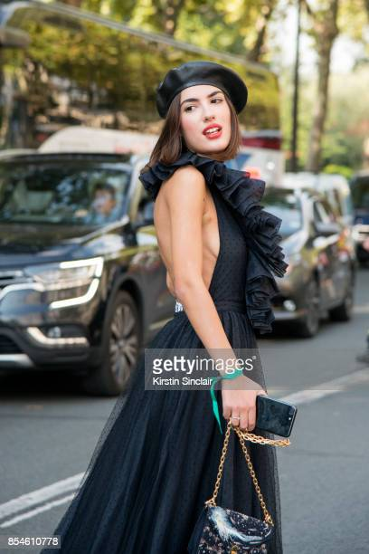Singer Patricia Manfield wears a Dior hat dress and bag day 1 of Paris Womens Fashion Week Spring/Summer 2018 on September 26 2017 in Paris France