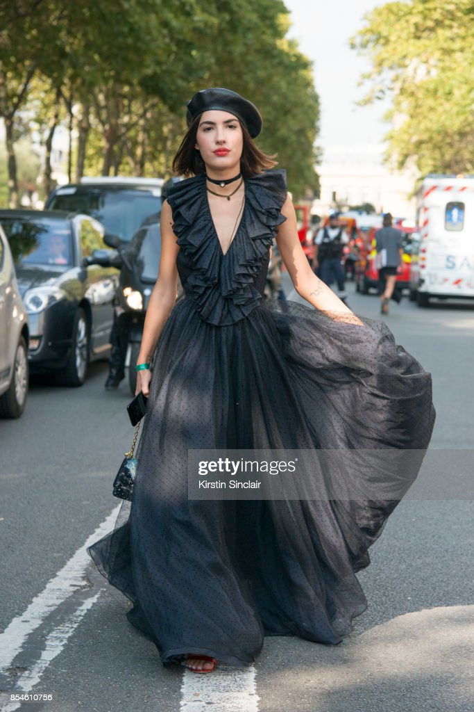 Singer Patricia Manfield wears a Dior hat, dress, shoes and bag day 1 of Paris Womens Fashion Week Spring/Summer 2018, on September 26, 2017 in Paris, France.