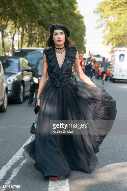 Singer Patricia Manfield wears a Dior hat dress shoes and bag day 1 of Paris Womens Fashion Week Spring/Summer 2018 on September 26 2017 in Paris...