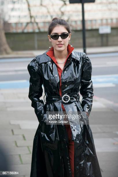 Singer Patricia Manfield wears an Alexandra Reich coat Stud jumpsuit Gucci sunglasses on day 4 of London Womens Fashion Week Autumn/Winter 2017 on...