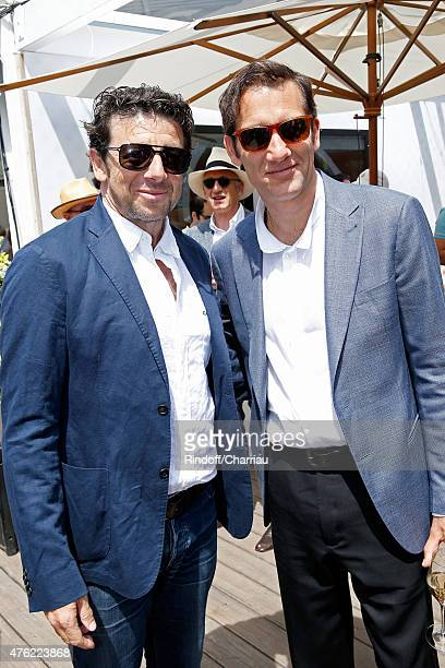 Singer Patrick Bruel and Actor Clive Owen attend the Men Final of 2015 Roland Garros French Tennis Open Day Fithteen on June 7 2015 in Paris France