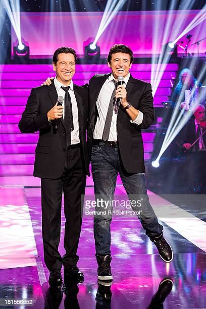 Singer Patrick Bruel and impersonator Laurent Gerra impersonating Bruel perform during the live broadcast on public channel France 2 of the program...