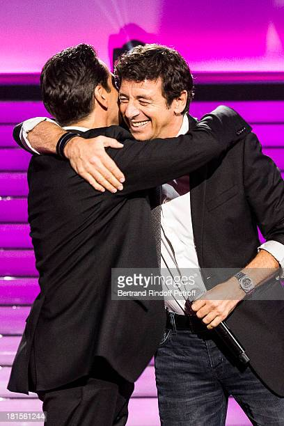 Singer Patrick Bruel and impersonator Laurent Gerra impersonating Bruel embrace after performing during the live broadcast on public channel France 2...