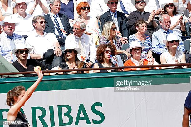 Singer Patrick Bruel Caroline Nielsen and Actress Alice Taglioni attend the 2015 Roland Garros French Tennis Open Day Eleven on June 3 2015 in Paris...
