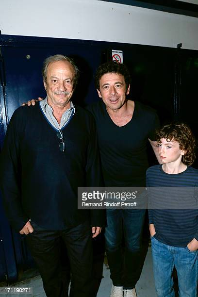 Singer Patrick Bruel standing between actor Patrick Chesnais and his son Victor attending the last concert in Paris of Patrick Bruel held at Palais...