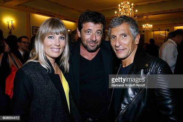 Singer Patrick Bruel standing between TV Presenter Nagui with his wife actress Melanie Page attend the 'Tout ce que vous voulez' Theater Play at...