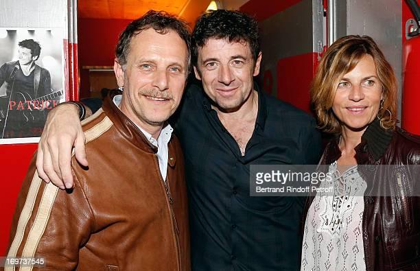 Singer Patrick Bruel stands between actor Charles Berling and his wife Virginie CouperieEiffel backstage after Patrick Bruel's concert at Zenith de...
