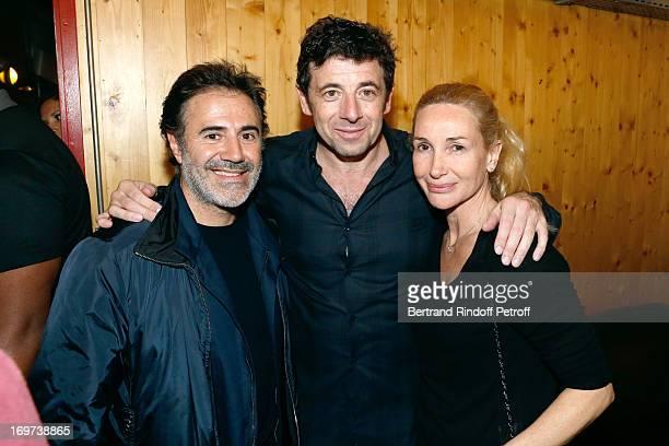 Singer Patrick Bruel stands between Actor Jose Garcia and his wife director Isabele Doval backstage after Patrick Bruel's concert at Zenith de Paris...