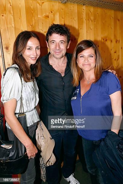 Singer Patrick Bruel stands between actresses Elsa Zylberstein and Charlotte Valandrey backstage after Patrick Bruel's concert at Zenith de Paris on...