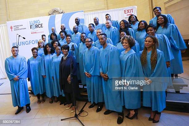Singer Patti LaBelle poses for photographs with the East Coast Inspirational Singers following their performance during the 3rd Annual National...