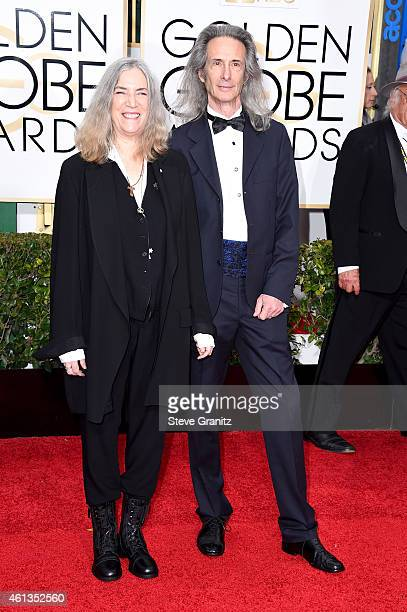 Singer Patti Smith and musician Lenny Kaye attend the 72nd Annual Golden Globe Awards at The Beverly Hilton Hotel on January 11 2015 in Beverly Hills...