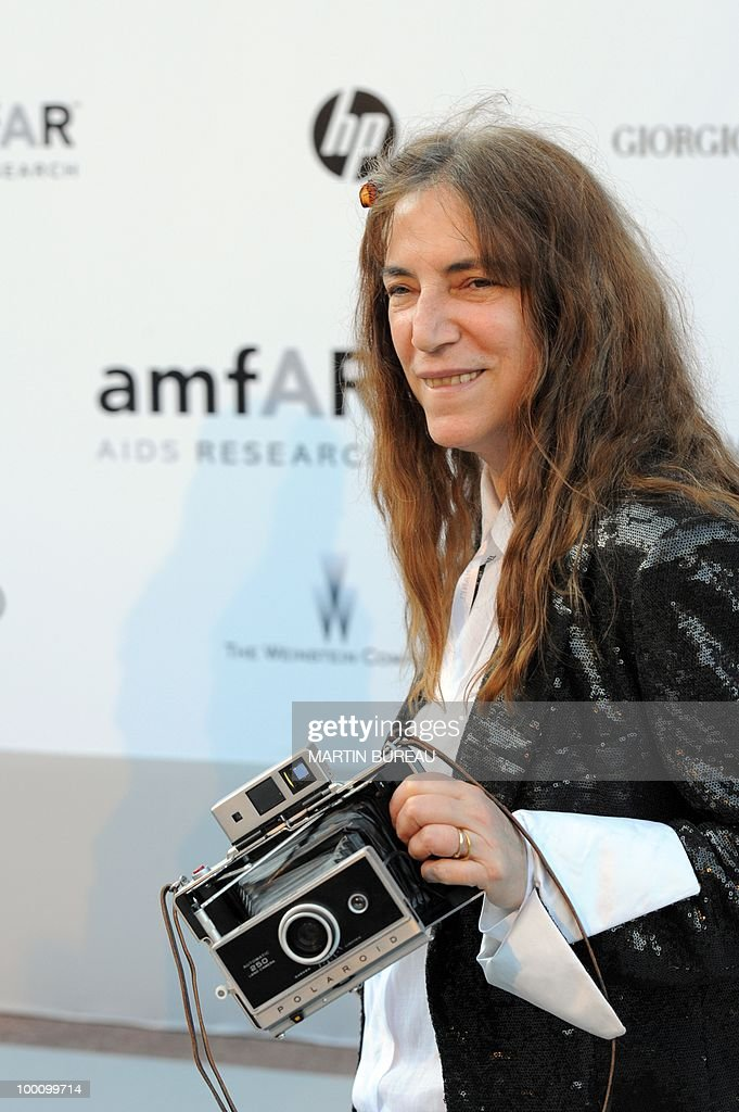 US singer Patti Smith arrives at amfAR's