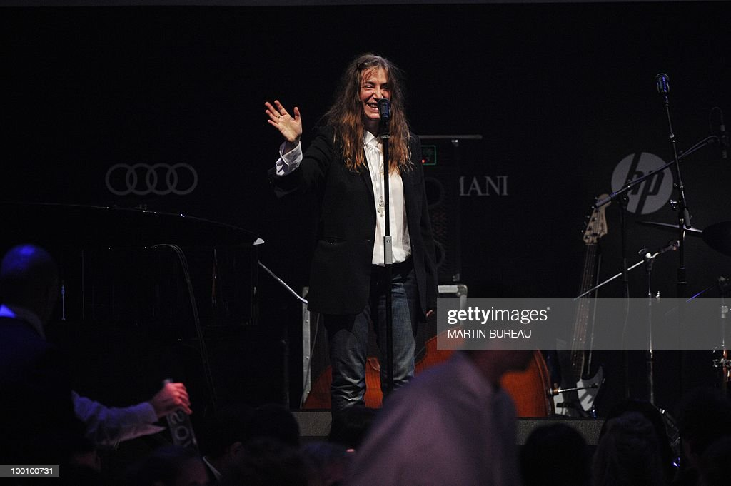 US singer Patti Smith performs at amfAR'
