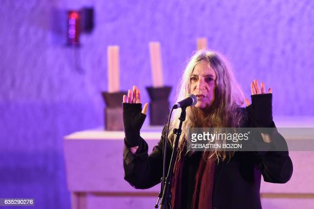 Singer Patti Smith performs on stage during the Generiq music festival on February 14 at the Ronchamp chapel designed by French architect Le...