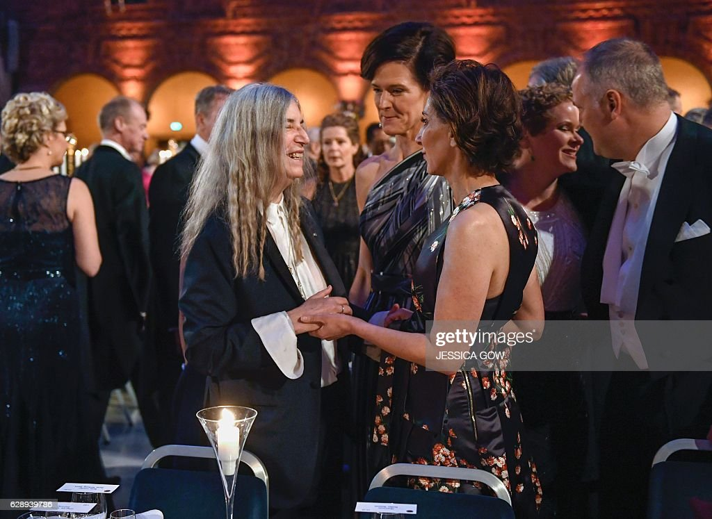 US singer Patti Smith (L) talks to Swedish conservative leader Anna Kinberg Batra (C) and US ambassador Azita Rajis (R) at the 2016 Nobel prize award banquet at the Stockholm City Hall on December 10, 2016. Ms. Smith performed one of Literature prizewinner Bob Dylan's songs at the award ceremony earlier on Saturday. News Agency / JESSICA GOW / Sweden OUT