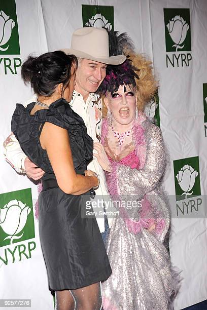 Singer Patti Smyth husband John McEnroe and founder of The New York Restoration Project singer Bette Midler attend the 14th Annual Bette Midler's New...