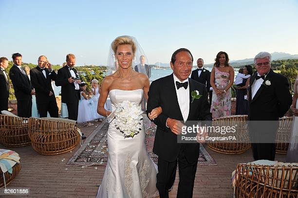 ACCESS*** Singer Paul Anka and Anna Anka walk their first few steps as husband and wife just after exchanging their vows at Hotel Cala di Volpe on...