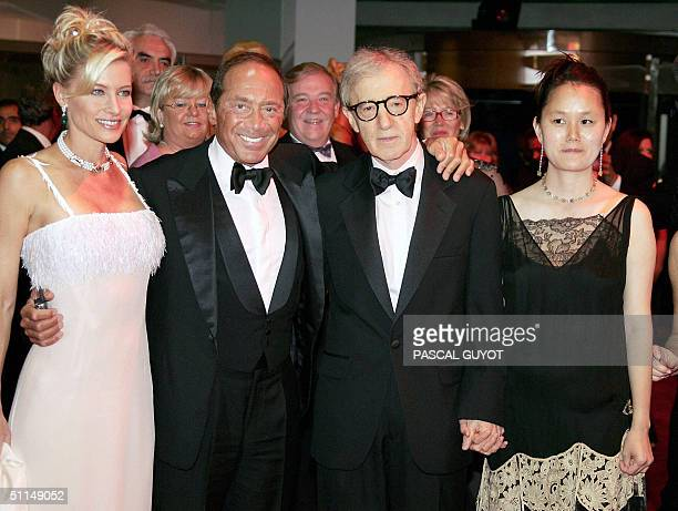 US singer Paul Anka and US filmmaker Woody Allen and his wife SoonYi arrive 06 August 2004 to attend the annual Red Cross Ball or Bal de la...