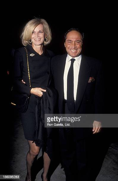 Singer Paul Anka and wife Anne DeZogheb being photographed on December 4 1993 at Spago Restaurant in West Hollywood California