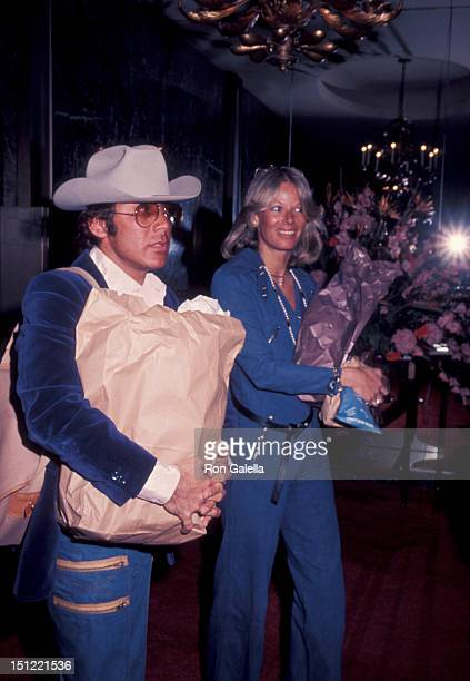 Singer Paul Anka and wife Anne DeZogheb being photographed on March 13 1976 at the Beverly Wilshire Hotel in Beverly Hills California