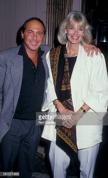 Singer Paul Anka and wife Anne DeZogheb being photographed on October 26 1987 at Knickerbocker Jazz Restaurant in New York City New York