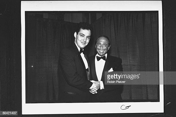 Singer Paul Anka chatting w Dodd Cassotto the son of the late Rock Roll Hall of Fame inductee Bobby Darin at awards banquet at the WaldorfAstoria...