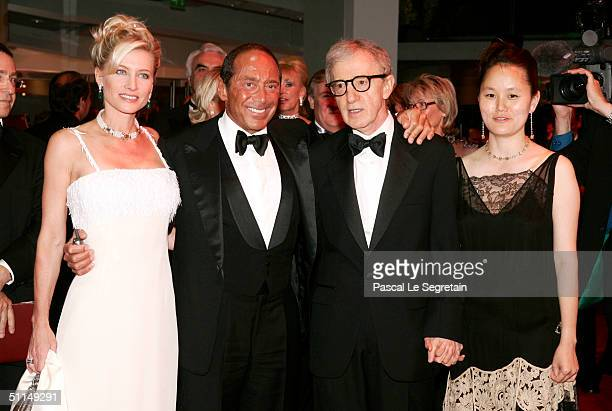 Singer Paul Anka his wife and filmmaker Woody Allen and his wife SoonYi arrive at the Monte Carlo Red Cross Ball 2004 held at the Salle des Etoiles...