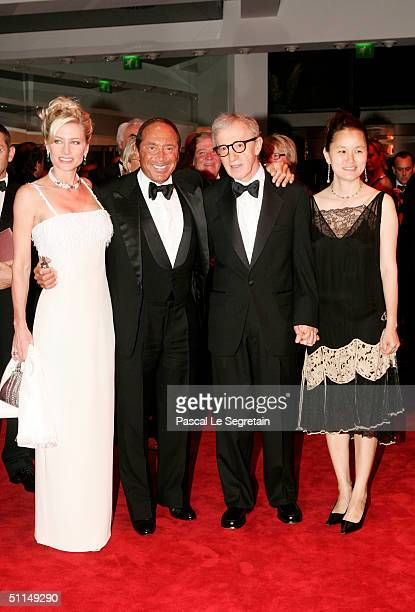 Singer Paul Anka his wife filmmaker Woody Allen and his wife SoonYi arrive at the Monte Carlo Red Cross Ball 2004 held at the Salle des Etoiles of...