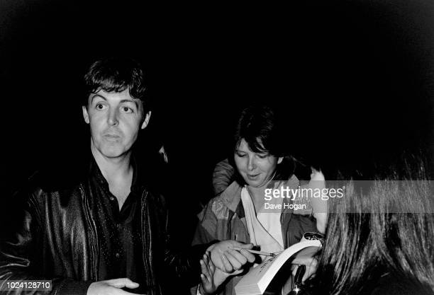 Singer Paul McCartney signs autographs outside Abbey Road Studios in London, December 1982.