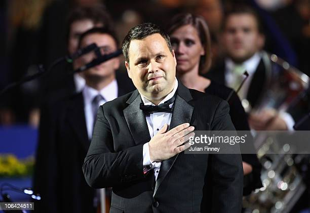 Singer Paul Potts thanks the support after performing at the openning of the tournament during Day One of the Davidoff Swiss Indoors Tennis at St...