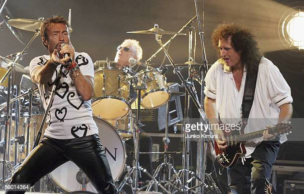 Singer Paul Rodgers Drummer Roger Taylor and guitarist Brian May of the British Rock group Queen perform at Saitama Super Arena on October 26 2005 in...