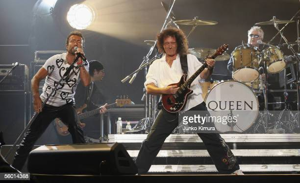 Singer Paul Rodgers guitarist Brian May and Drummer Roger Taylor of the British Rock group Queen perform at Saitama Super Arena on October 26 2005 in...