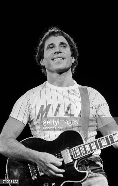 singer paul simon plays guitar during a 1980 concert at the news photo getty images. Black Bedroom Furniture Sets. Home Design Ideas