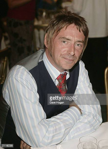 OUT} Singer Paul Weller is seen at his table at the Nordoff Robbins Silver clef Awards held at the Hotel Intercontinental on June 27 2003 in London