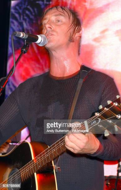 Singer Paul Weller performing on stage at HMV in Oxford Street London to celebrate the release of his new album 'Fly On The Bal