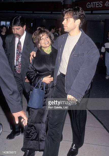 Singer Paula Abdul and husband Brad Beckerman arrive from New York City on April 2 1997 at the Los Angeles International Airport in Los Angeles...