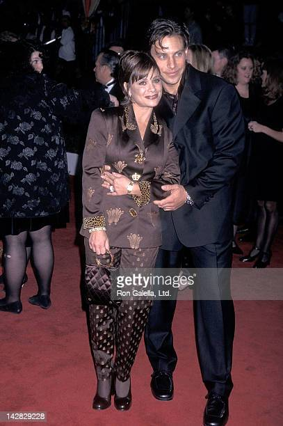 Singer Paula Abdul and husband Brad Beckerman attend the Evita Los Angeles Premiere on December 14 1996 at the Shrine Auditorium in Los Angeles...
