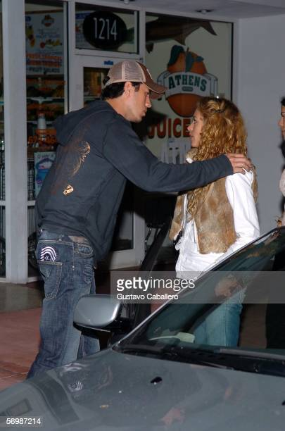 Singer Paulina Rubio and Enrique Iglesias stand outside a Miami Beach restaurant after a late night meeting on March 3 2006 in Miami Beach Florida