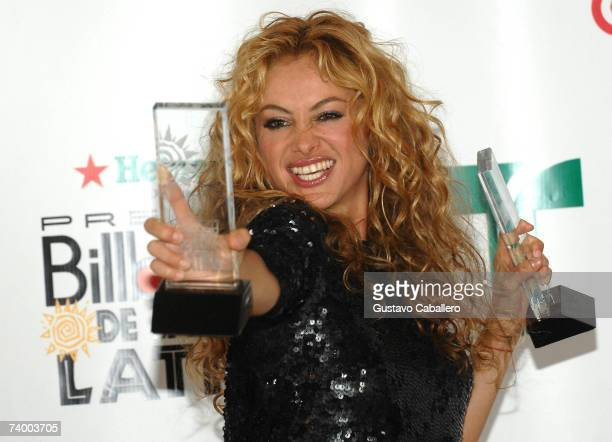 """Singer Paulina Rubio poses with the """"Latin Pop Album of the Year"""" and Latin Pop Airplay Song Of The Year - Female"""" awards in the press room at the..."""