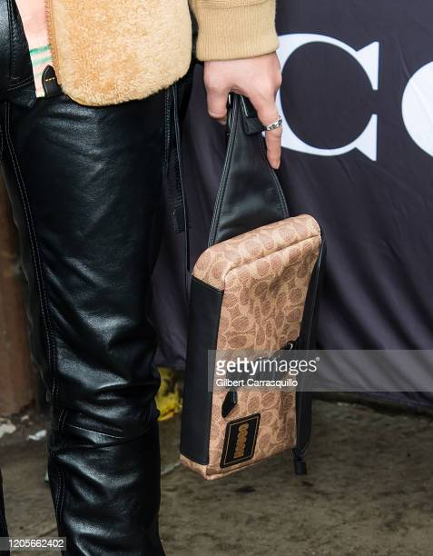 Singer Peck, handbag detail, is seen leaving the Coach 1941 fashion show during New York Fashion Week on February 11, 2020 in New York City.