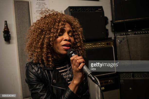 singer performing in a recording studio - soul music stock pictures, royalty-free photos & images
