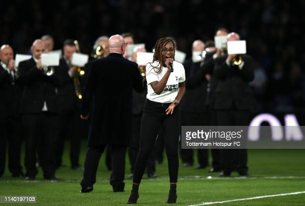 A singer performs during the Opening Ceremony of the Tottenham Hotspur Stadium prior to the Premier League match between Tottenham Hotspur and...