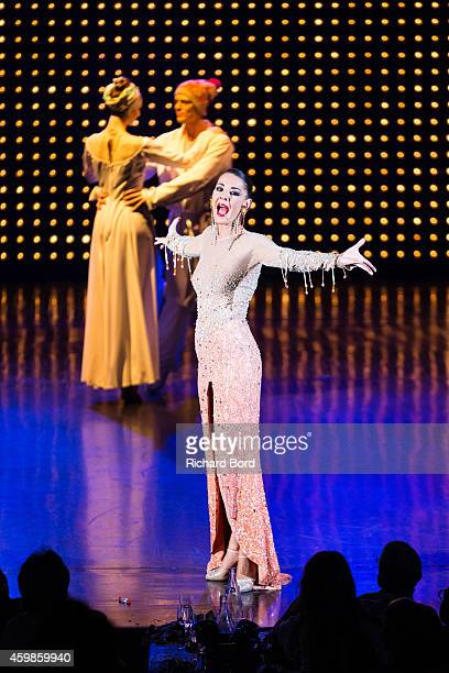 A singer performs onstage during the last show of the 'Bonheur' Revue at the Lido on December 2 2014 in Paris France
