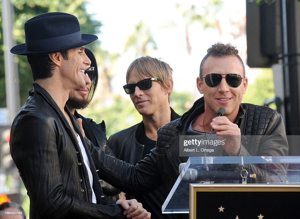 Singer Perry Farrell, guitarist Dave Navaro, bassist Chris Chaney and drummer Stephen Perkins at Jane's Addiction Star On The Hollywood Walk Of Fame Ceremoney on October 30, 2013 in Hollywood, California.