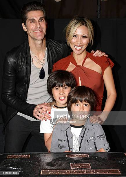 Singer Perry Farrell wife Etty Lau and sons Hezron Wolfgang and Izzadore Bravo attend the induction of Jane's Addiction into Hollywood's Rockwalk at...